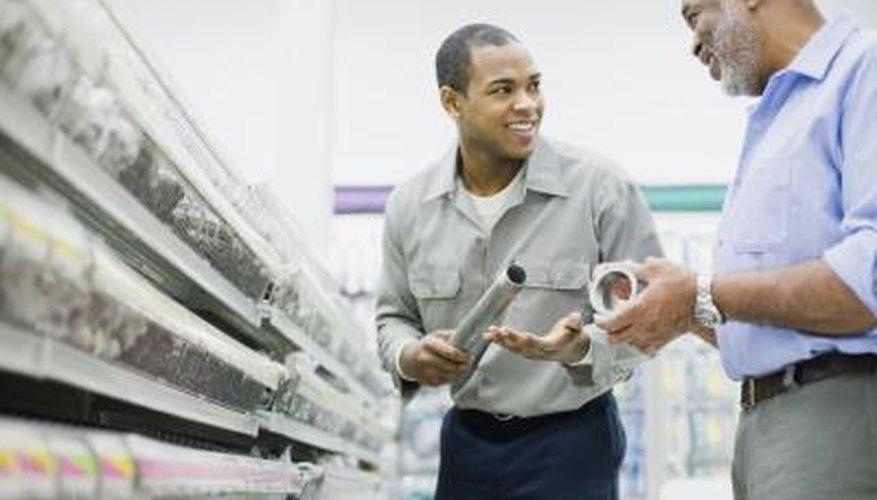 Men shopping in hardware store for supplies