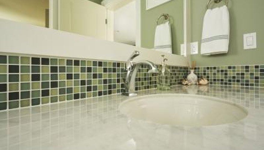 Colorful green tiling around sink