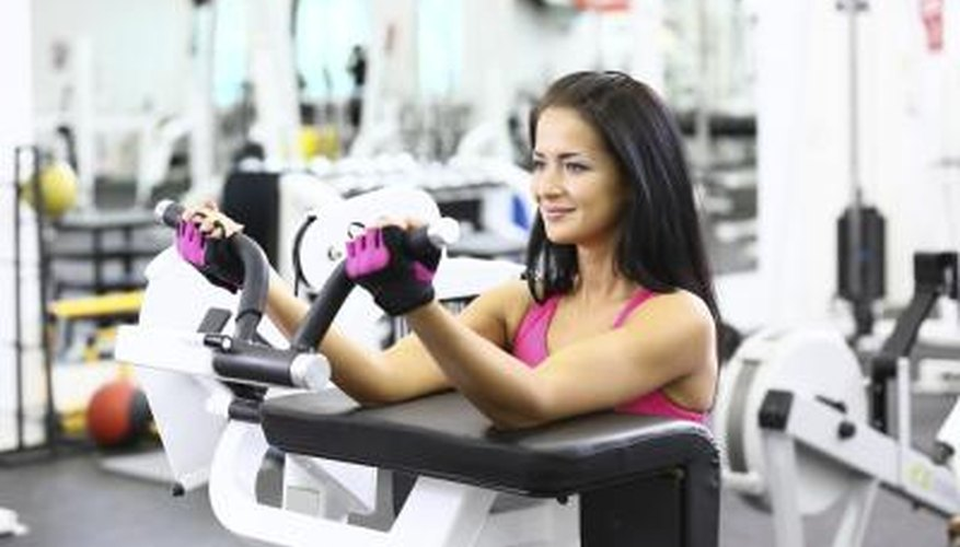 Woman uses exercise machine