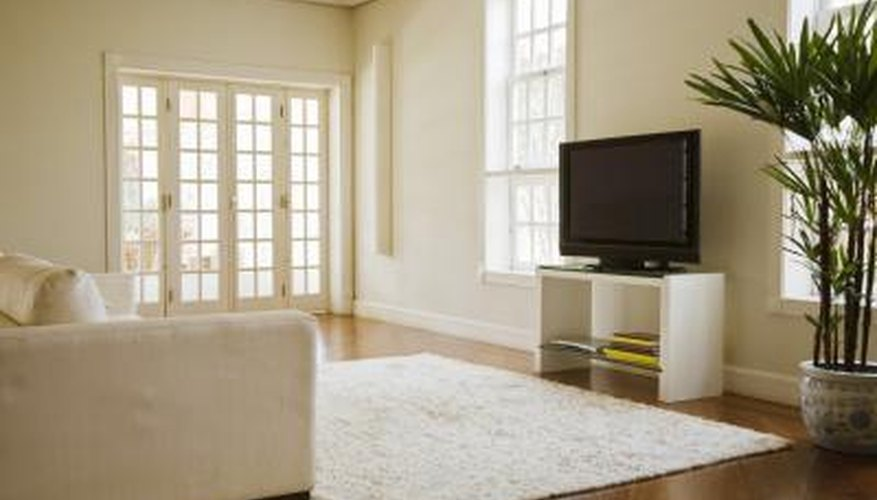 Dark flooring offers visually pleasing color contrast against white furnishings.