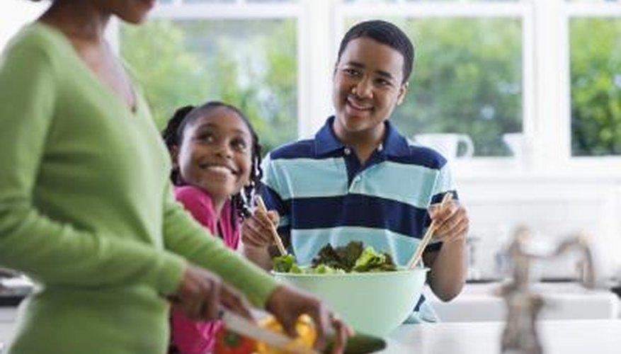 Woman in kitchen with children