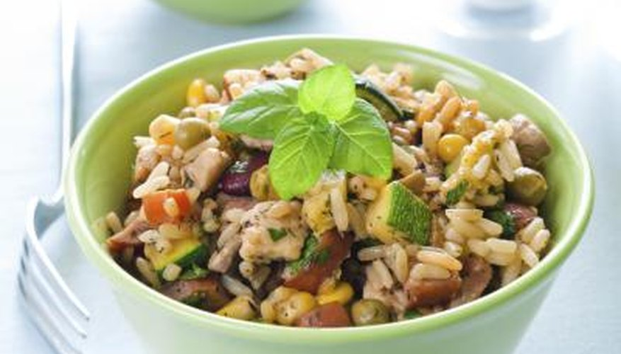 A bowl of risotto with a variety of beans and vegetables.