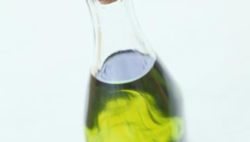 Olive oil in clear jar.
