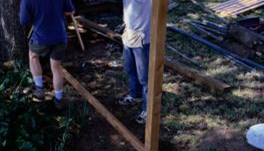 Neighbors often share the cost and labor of building a fence.