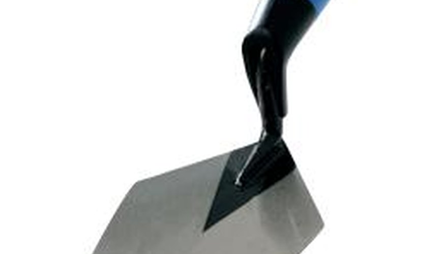 Use the trowel to lay and strike mortar, and butter the bricks.