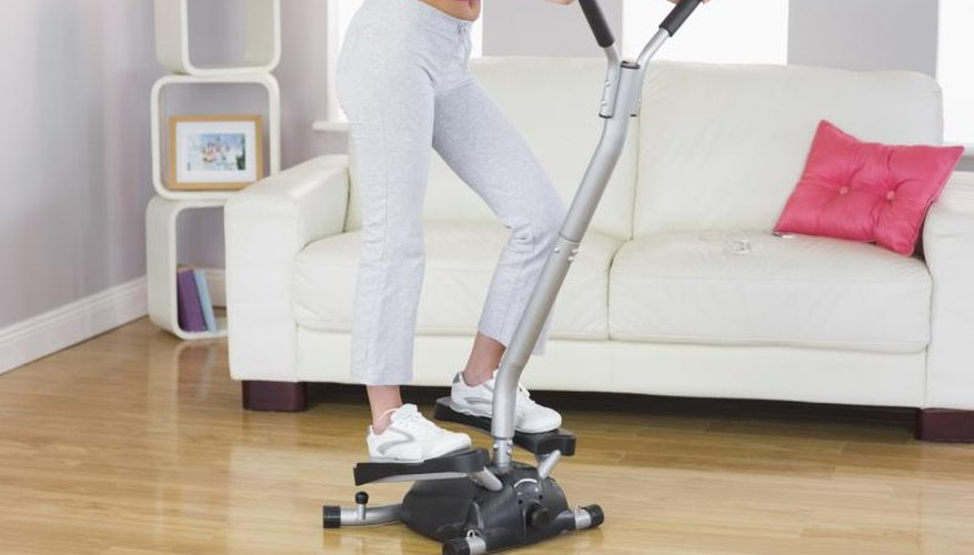 A woman is training on a step machine.