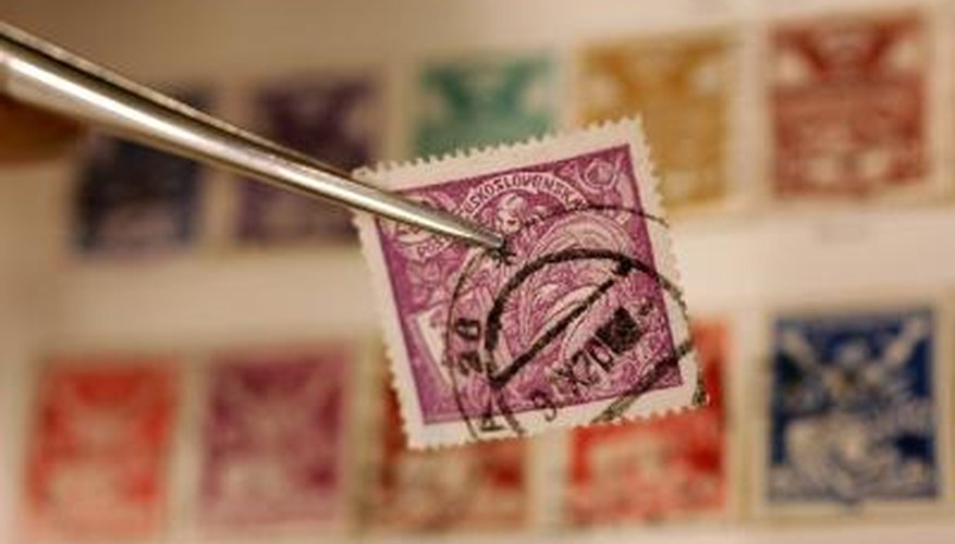 Rare stamp being held by tweezers