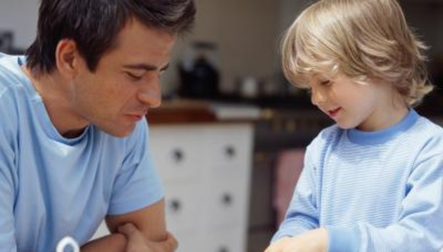 A father and son prepare a bowl of cereal together in the morning.