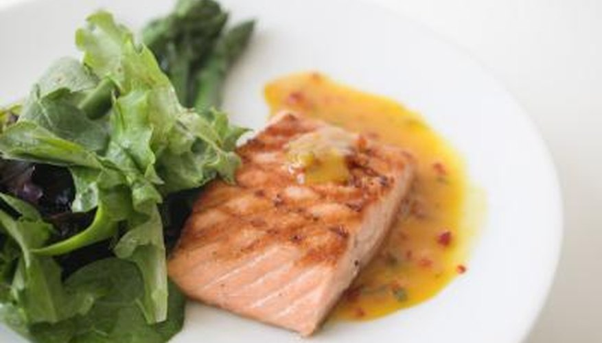 A plate of grilled salmon and salad.