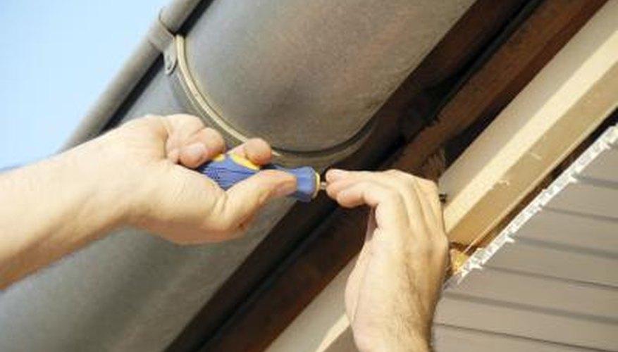 Man installing new gutters