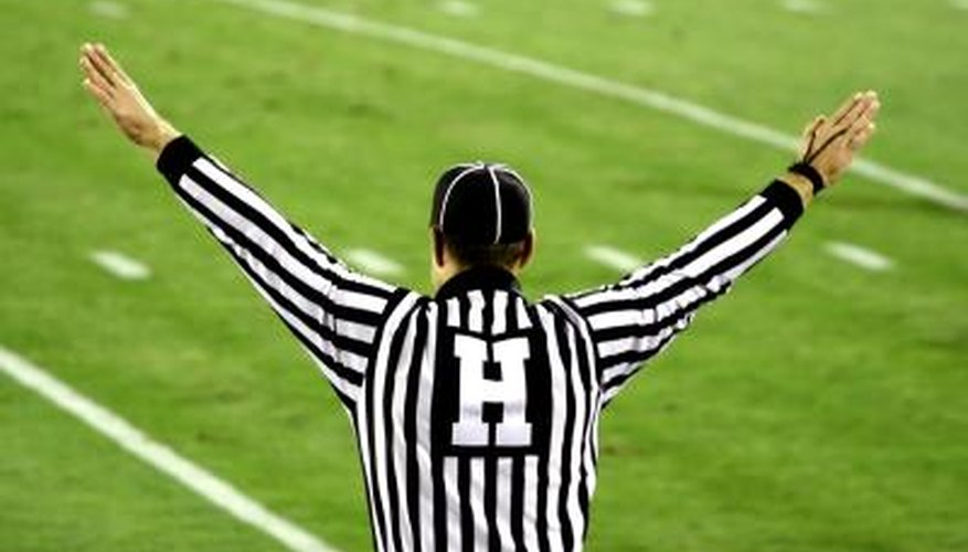 Football official signals on field