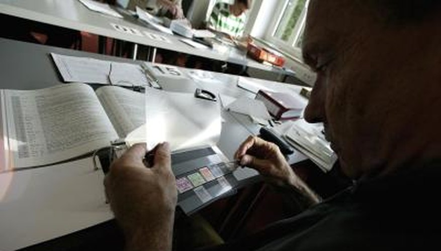 A collector examines stamps