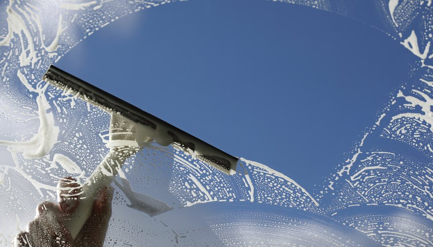 Use a broad, semi-circular stroke to clean large panes.