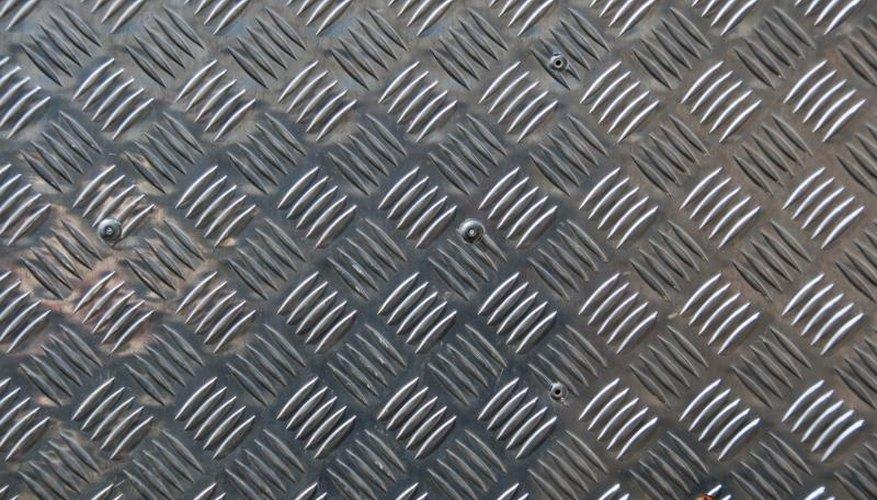 Close-up of a diamond-pattern aluminum sheet.