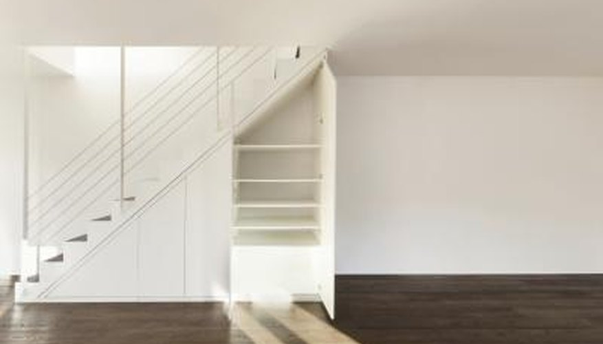 A storage space underneath a set of stairs.