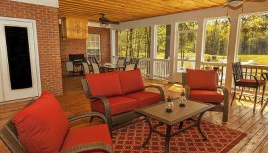 A sunroom with honey toned hardwood flooring.