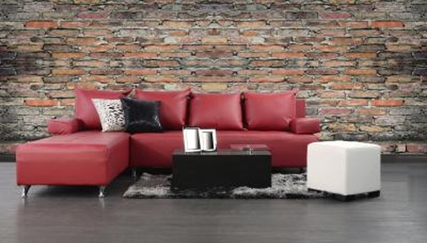 red leather couch with contrasting block tables and throw pillows