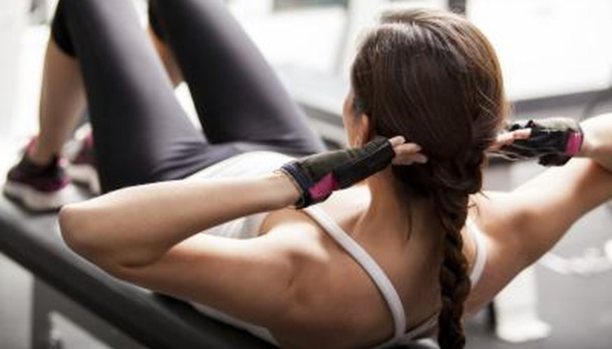 Woman doing crunches in gym.