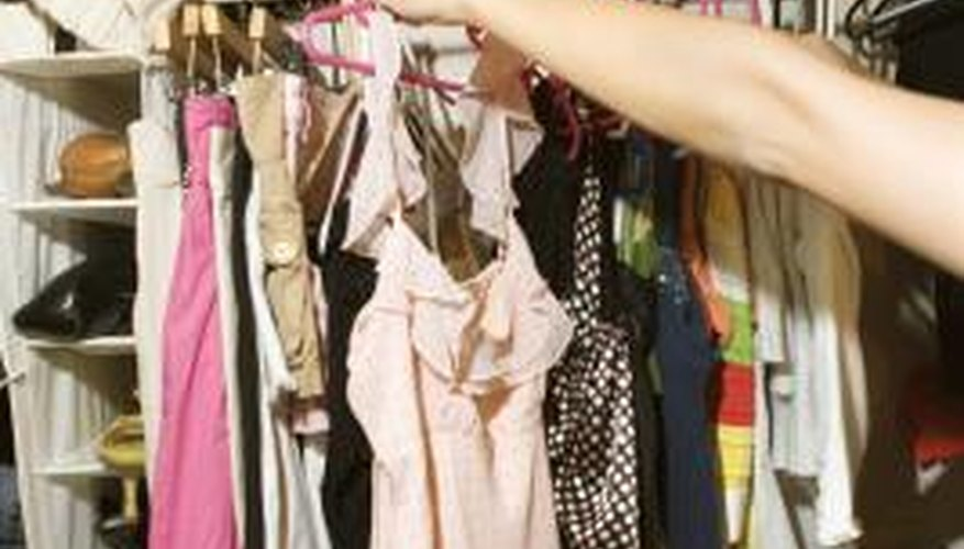 Add hanging rods and shelves to begin storing your clothes.