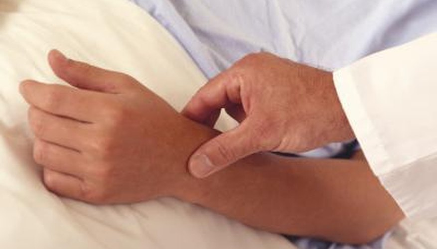 Doctor touching patients hand