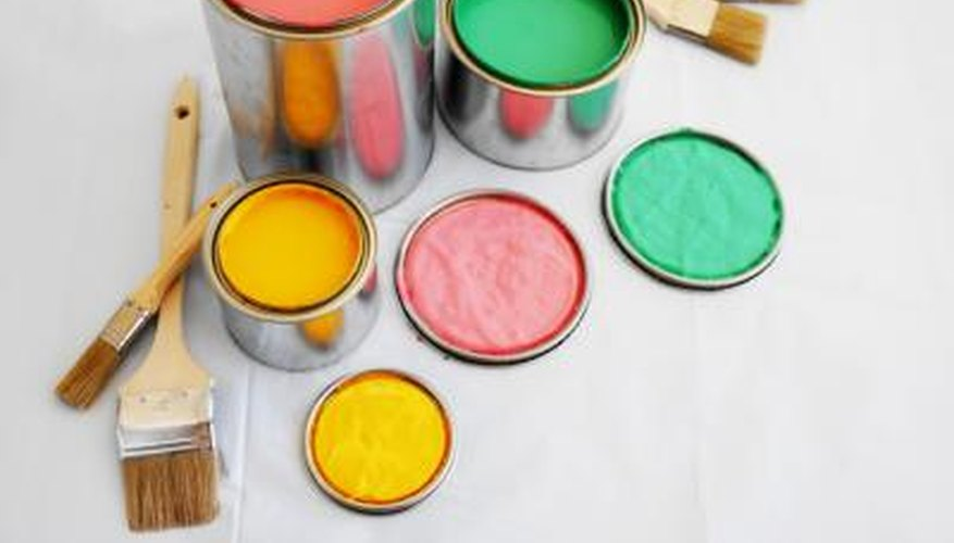 Open paint cans and brushes on floor.