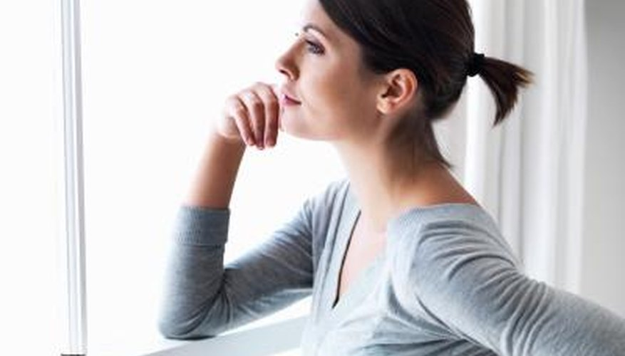 Woman thoughtfully looking out window