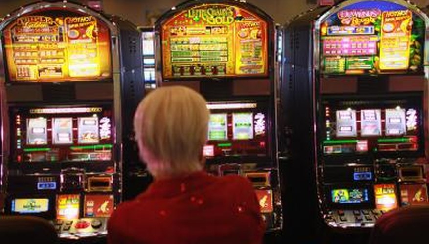 Woman trying her luck on slot machine