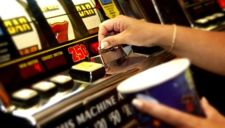 Hands playing slot machine