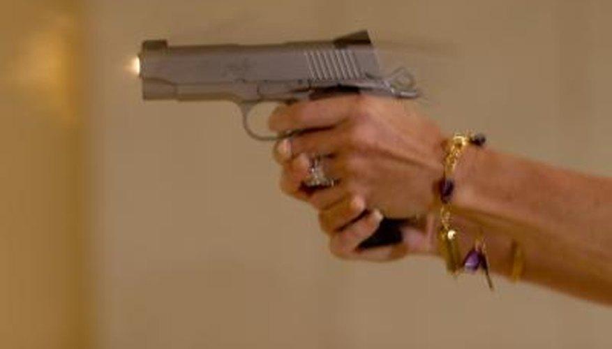 Woman shoots pistol on gun range
