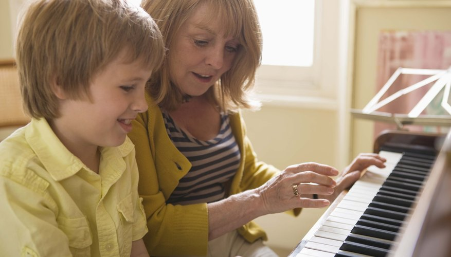 Woman playing piano with grandson