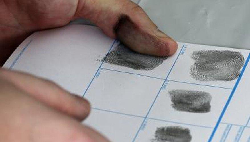 Concealed gun permit user being fingerprinted