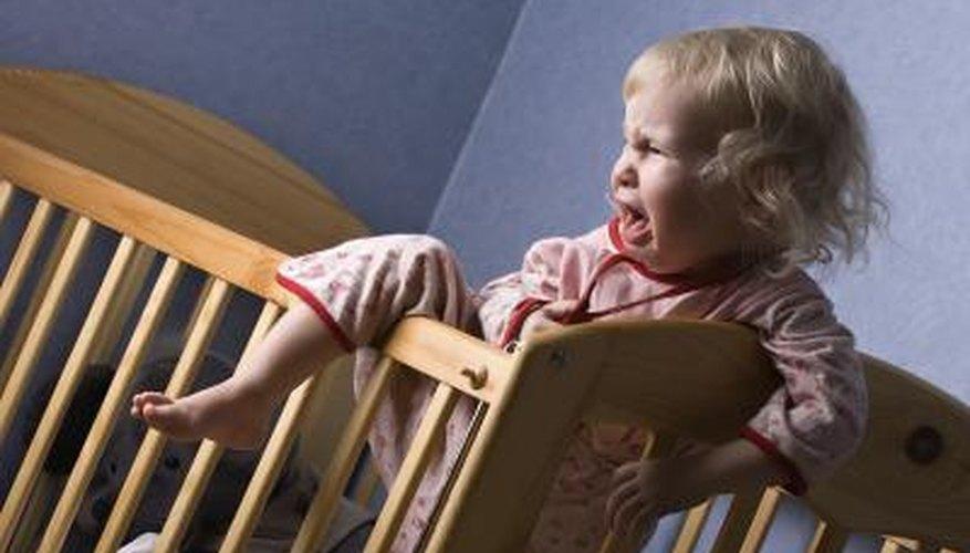 Uncomfortable infant in crib.