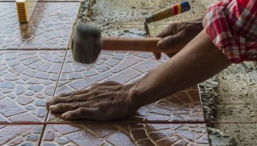 The installation of a mosaic floor using stone tiles.