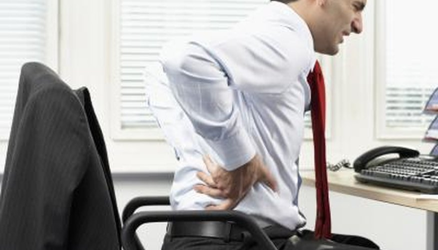 Sitting for long hours in a desk chair, especially one with poor back support, can cause lower back pain.
