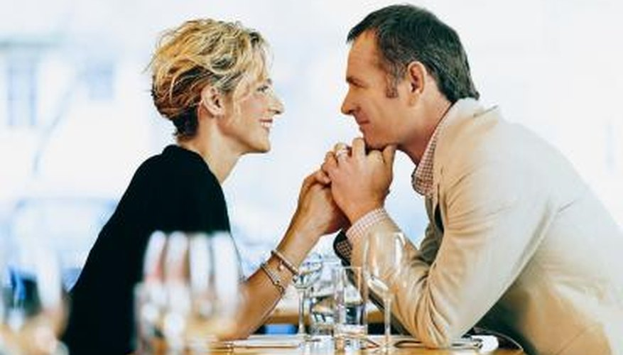 man listening to woman at restaurant