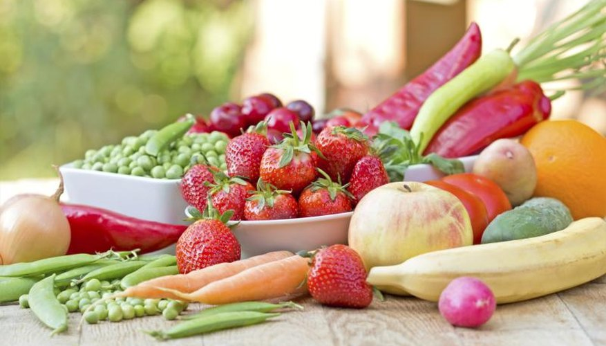 Fresh fruits and vegetables on an outdoor table.