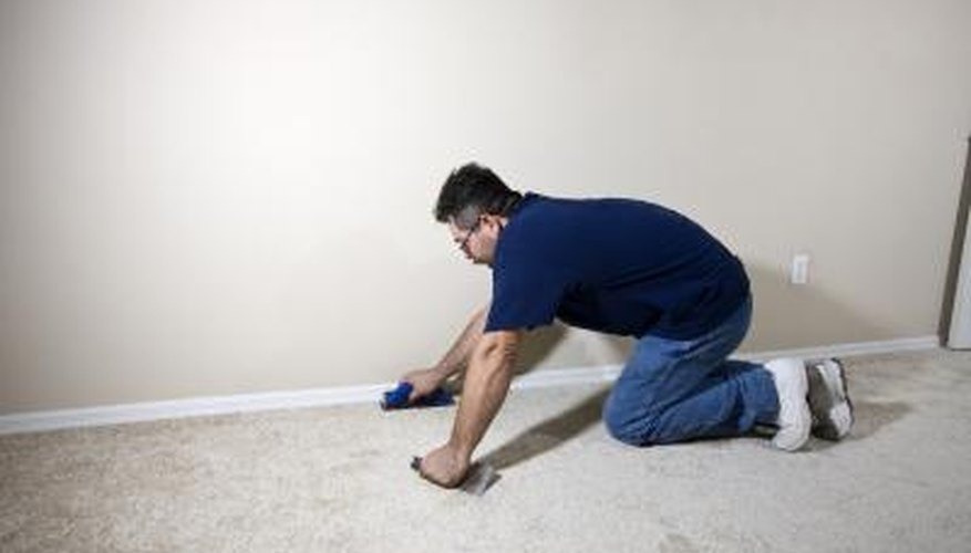 Professional carpet installer works to remove old carpet entirely