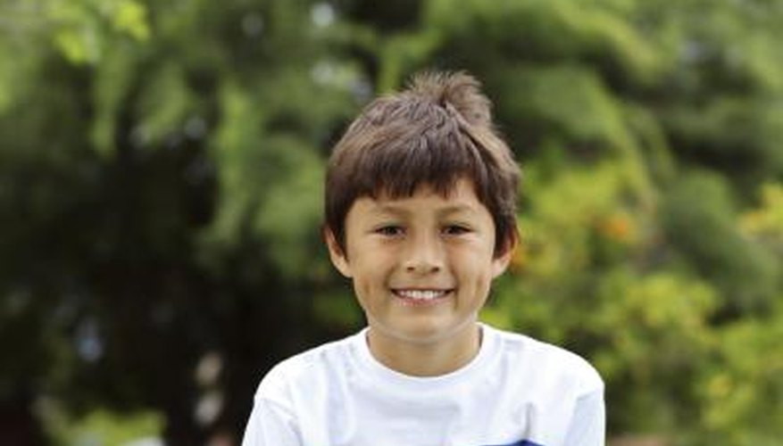 A young smiling boy with dimples.