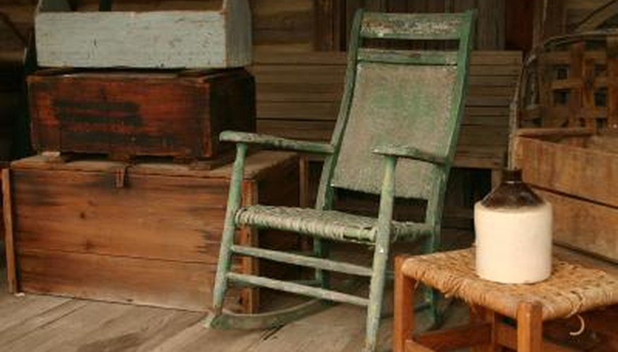 An old rocking chair in an antique shop. - How To Identify An Antique Rocking Chair Our Pastimes