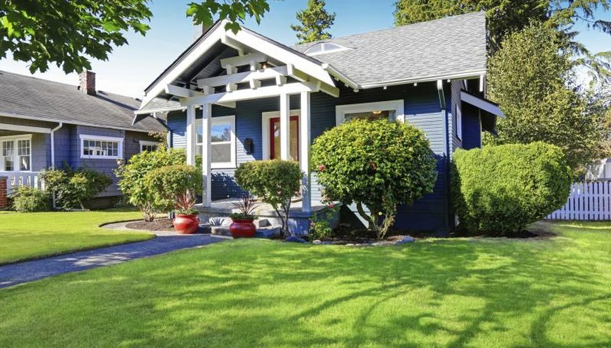 Easy Front Yard Landscaping Ideas Part - 44: A Bungalow With An Ornamental Tree And Evergreen Shrub At The Corner.