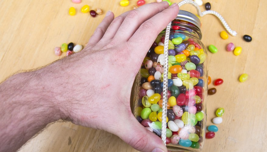 Measure the jars height in jelly beans.