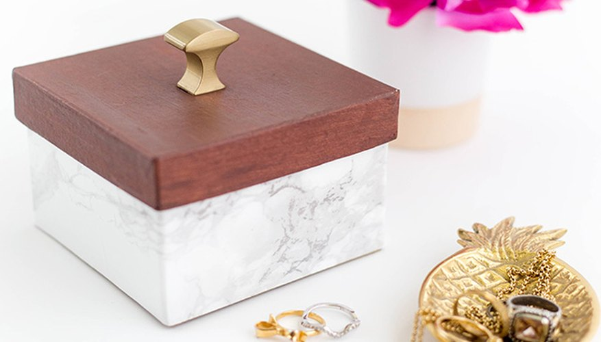 This DIY faux wood and marble box looks just like the designer version.