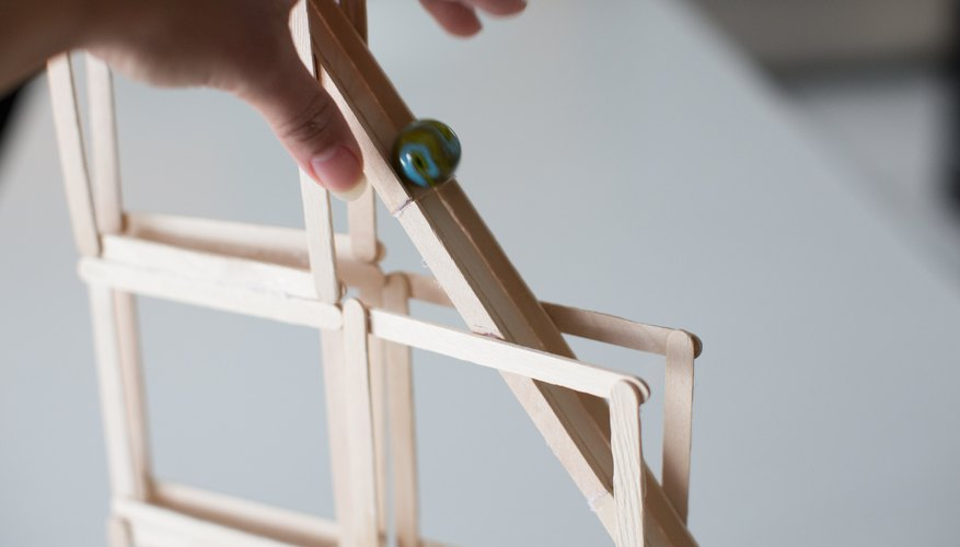 How to make roller coasters for a science fair project sciencing test with a marble wait for the glue to dry completely before testing with a marble test each layer as it is built when time permits fandeluxe Image collections