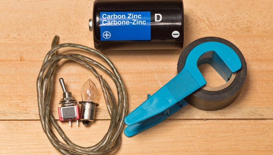 Make a light bulb work with a battery using a common battery pieces of copper wire and a flashlight bulb. These steps create a simple circuit. & How to Make a Light Bulb Work With a Battery | Sciencing azcodes.com