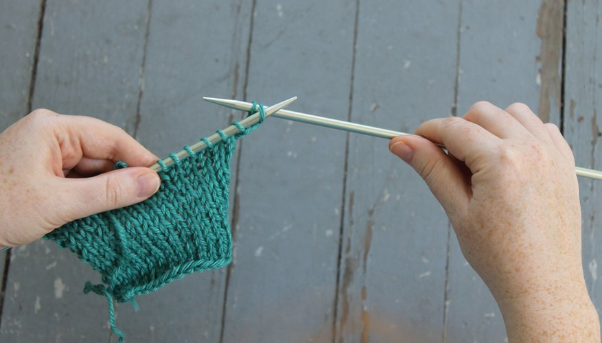 Inserting the left needle into the stitch to bind off