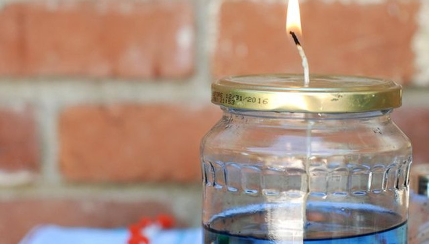 Add color to ordinary tiki torch oil with wax tints.