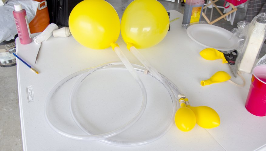 Inflate the double-layered balloons and allow air to flow to single balloons.