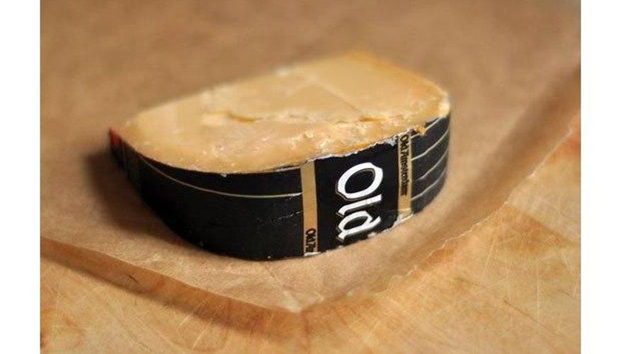 Rebanada de queso untada con mantequilla