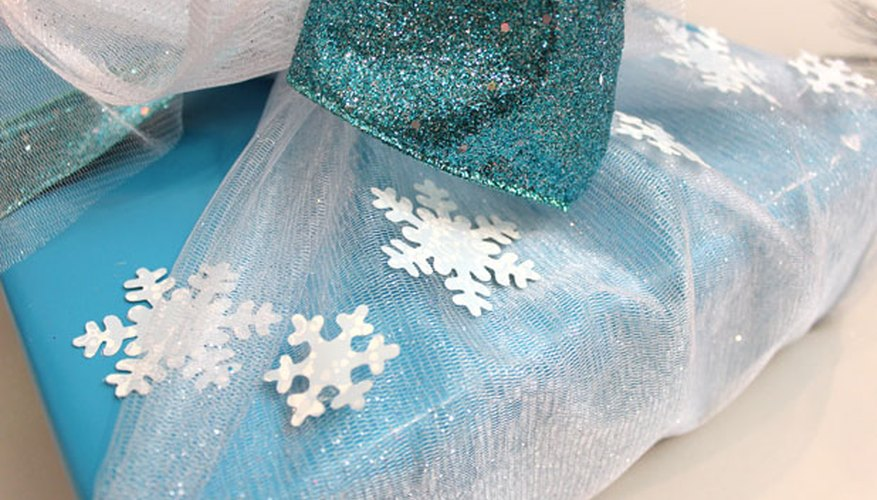 Glue paper snowflakes to the organza.