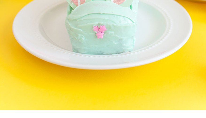 Decorating the bunny cakes.